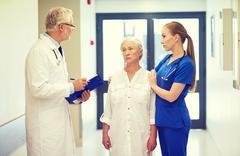 medics and senior patient woman at hospital - stock photo