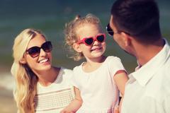 happy family in sunglasses on summer beach - stock photo