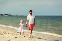 happy family in sunglasses on summer beach - stock photo