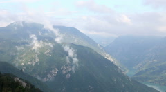 Clouds flying over mountain landscape Arkistovideo