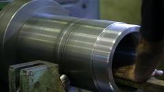 Man worker polishing metal part inside machine tool Stock Footage