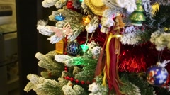 Christmas tree with lots of different toys in the living room Stock Footage