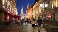 People walk through the historic center of the city on Nikolskaya Street Stock Footage