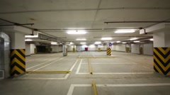 Movement on an empty parking garage to the girl on roller skates Stock Footage
