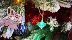 Christmas tree decorated with artificial snow and toys closeup Stock Footage