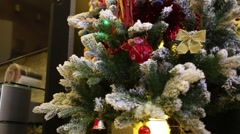 Beautifully decorated Christmas tree stands next to the TV Stock Footage