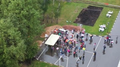 Many people with balloons and umbrellas on the playground Stock Footage