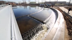 Large sewage tank on the territory of treatment plant on a sunny day Stock Footage