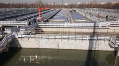 People stand on the platform near the aeration tanks Stock Footage