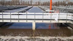 The wastewater flows into the aeration tank at treatment facilities Stock Footage