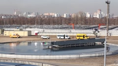 Sewage treatment plant next to the big city on a sunny day Stock Footage