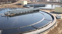 Sedimentation basin, sewage flowing through large tanks Stock Footage