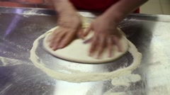 The man rolls the dough by hand and the roller with spikes Stock Footage