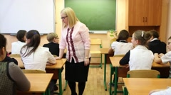 Nine people in the class: teacher stands and talking with students Stock Footage
