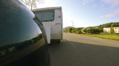 White  caravan ,trailer go  on   road . Life on travel Stock Footage