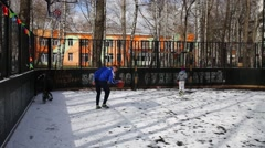 Two boys playing in the snow-covered playground. Stock Footage