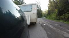 White  caravan ,trailer go  on   road . Life on travel, sunny morning Stock Footage