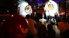 People with large illuminated fishes during the festival Bright people Stock Footage