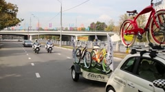 Cars of police forces provide security of bike parade Stock Footage