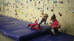 Two girls smeared hand with magnesia next to the climbing wall Stock Footage