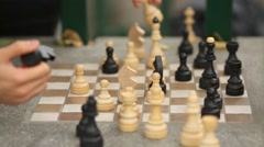 Chess pieces on the board in the park during the game Stock Footage