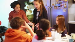 Children sit during tea party at table in kitchen. Stock Footage