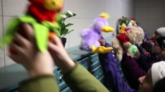 Group of children put fluffy toys upon mailboxes at entrance hall Stock Footage