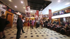 People in foyer of theater Sphere on the day of media preview Stock Footage