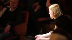 Actress I.Mrezhenova tells story sitting among spectators Stock Footage