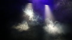 Swirling clouds of smoke over stage under projectors light. Stock Footage