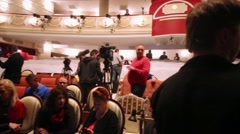 Press representatives leave auditorium after media preview of Boris Godunov Stock Footage
