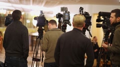 Cameramen before shoot interview in foyer of Moscow theatre Et Cetera Stock Footage