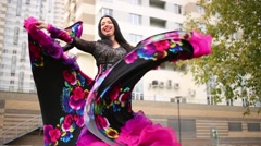 One young gipsy woman in a skirt with print of flowers are dancing. Stock Footage