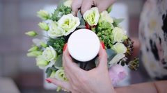 Wedding Candlestick with Flower Decoration Before Ceremony. Florist at Work Stock Footage