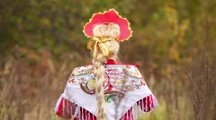 One woman in dress with kokoshnik is standing and doing arms sideward Stock Footage