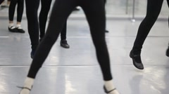 Girls are training steps one after another at the ballet class. Stock Footage