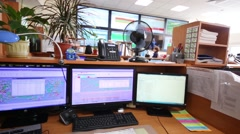Workplace with a four monitors and plants near big screens Stock Footage