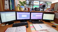 Workplace with a four monitors and many documents Stock Footage