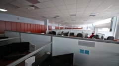 Workers are sitting at workplace with a partitions and switching on light Stock Footage
