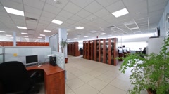Big office with partitions workplaces and plants in Moscow city telephone Stock Footage