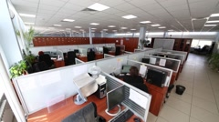 Office with a many partitions workplaces and workers Stock Footage