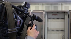 Operator is recording video at communications room Stock Footage