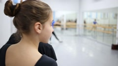Girl in blue T-shirt is whirling at the training on ballet class. Stock Footage