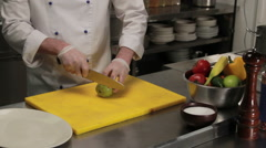 Chef slicing a peer, medium shot Stock Footage