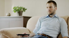 Man sitting in front of the TV Stock Footage