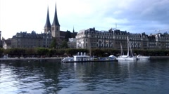 Lakeside view of Lucerne city from the Boat in Switzerland Stock Footage