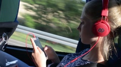Girl listening to Music on Mobile Sell Phone in autobus Stock Footage