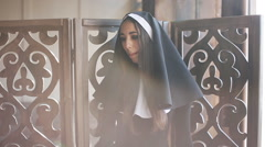 Sexy bad nun in church Stock Footage