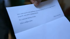 Close up of love letter written by bride to her groom Stock Footage
