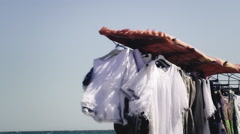 Clothes stand peddler sea detail Stock Footage